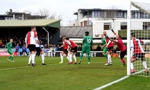 Will Hughes (left) finds a gap through a host of players following a pulled-back corner to give Watford an early lead at Woking.