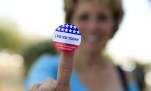 Deborah Kelly shows her voting sticker after casting ballot in U.S. presidential primary election in ArizonaDeborah Kelly, who waited in line 45 minutes to vote in a U.S. presidential primary election, shows her voting sticker outside a polling site in Glendale, Arizona March 22, 2016. REUTERS/Nancy Wiechec EDITORIAL USE ONLY. NO RESALES. NO ARCHIVE