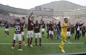 Players of Brazil's Flamengo celebrate after they defeated Argentina's River Plate 2-1 to win the the Copa Libertadores final.