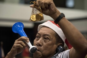 A trader blows a horn as he celebrates the last day of trading at the Philippine Stock Exchange in Manila on December 29, 2017. / AFP PHOTO / NOEL CELISNOEL CELIS/AFP/Getty Images