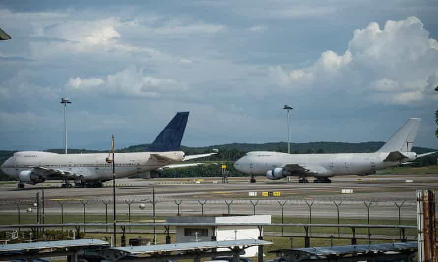 Unclaimed Boeing 747s with registration numbers as TF-ARM (L) and TF-ARN (R) at Kuala Lumpur international airport.