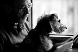 This shot of a man and his dog travelling by train, which has won first place in the man's best friend category, was taken by the UK's Fiona Sami