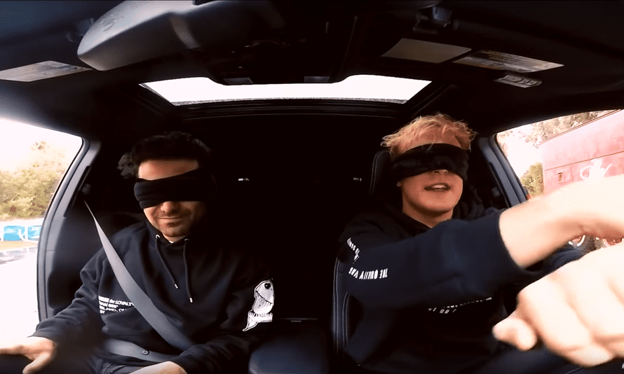 YouTubers George Janko (left) and Jake Paul (R) attempt to drive while blindfolded as part of the Bird Box challenge, based on the Netflix movie Bird Box. Netflix has expressly disclaimed the challenge.