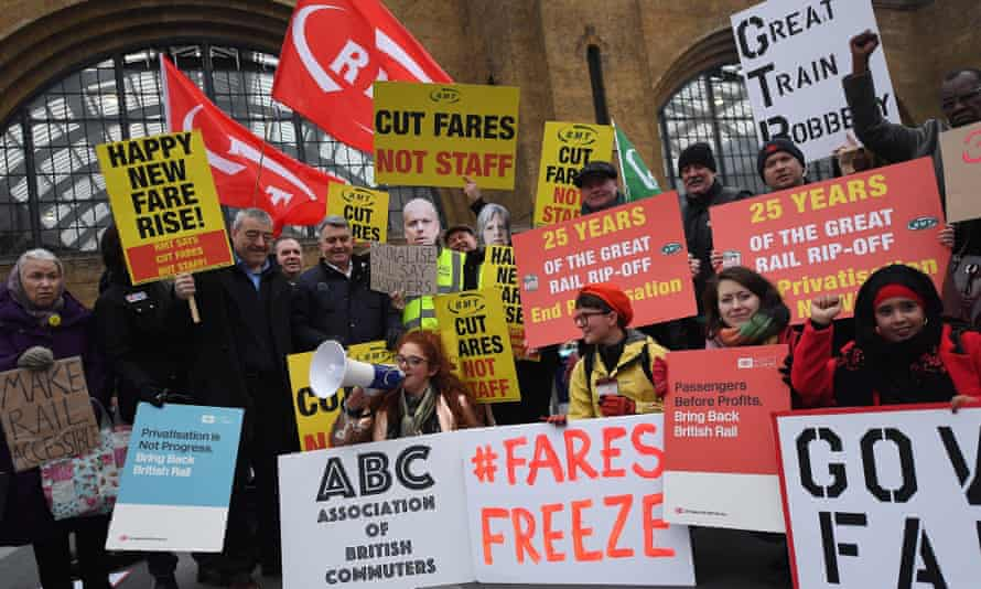 Protesters demonstrate against rail fare increases of 3.1% at King's Cross station in London on 2 January.