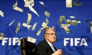 Money all round: Sepp Blater confronts the future as false dollar bills fall to the ground all around him.