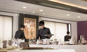Staff in the dining area of T hotel, Hong Kong.