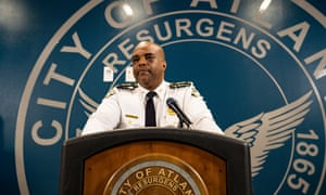 Atlanta deputy chief Charles Hampton speaks at a news conference on March 18.