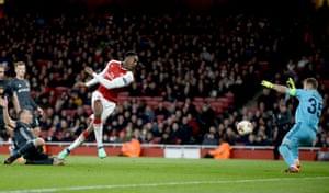 Danny Welbeck of Arsenal has a shot saved by CSKA keeper Igor Akinfeev.