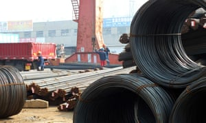 Chinese workers loading steel