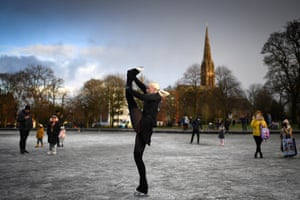 Glasgow, Scotland – Suzie Murray skates on Queen's Park pond as new Covid–19 rules come into effect. New lockdown restrictions forbidding people from leaving home for non-essential reasons have come into force across the Scottish mainland.