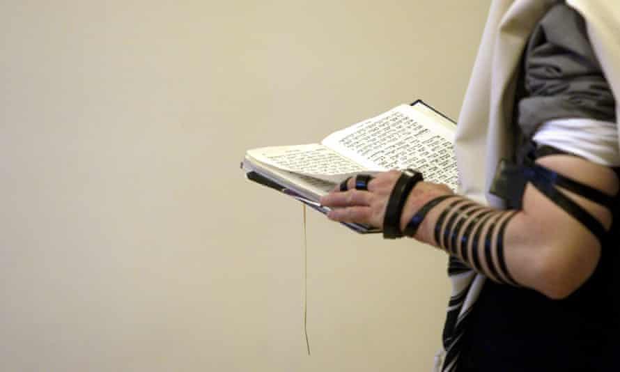 An orthodox Jew prays.