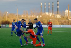 In this photo taken on Thursday, March 19, 2020, players are in action during the Belarus Championship soccer match between Energetik-BGU and Bate in Minsk, Belarus.