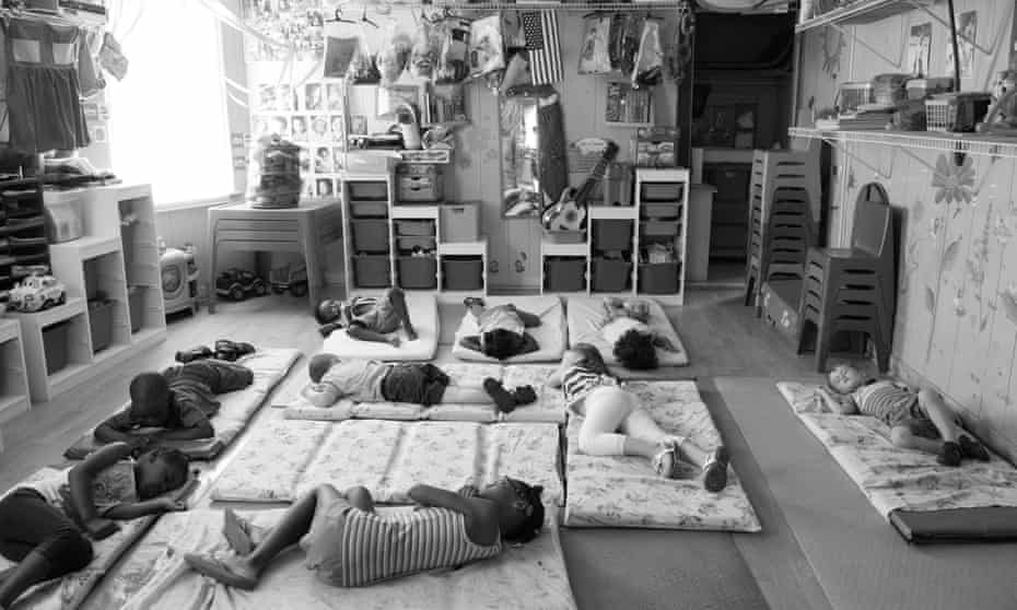 Children nap in the afternoon at Dee's Tots Childcare. Co-owners Deloris and Patrick Hogan care for children at their home seven days a week and most weeknights. The couple sleeps four hours each weeknight.