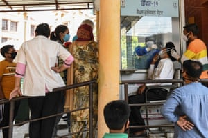 A health worker collects a nasal swab sample from a man to test for the Covid-19 coronavirus at the Civil hospital in Amritsar on 19 March, 2021 as coronavirus cases continue to increase.