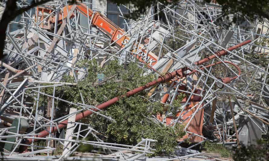 Rubble covers a lift and is strewn across a street after a scaffolding collapse at a building under construction in Houston.