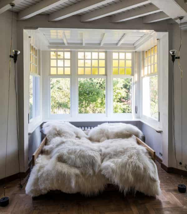 Skin deep: rugs on the bed in the light and airy Arts and Crafts house.