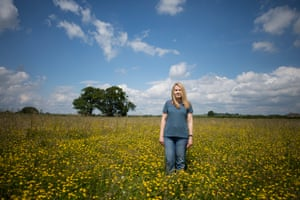Sarah Houlston in a field of flowers.