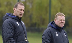 Everton's manager Ronald Koeman, right and the assistant coach Duncan Ferguson keep an eye on their players during training at Finch Farm.