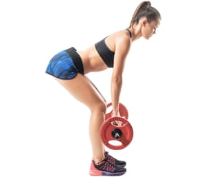 Side view of athletic woman doing deadlift exercise in low start position.