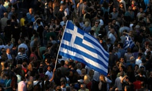 Protesters wave a Greek flag during an anti-austerity rally in Athens.