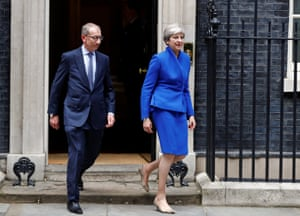Theresa May leaves Downing Street with her husband on the way to Buckingham Palace