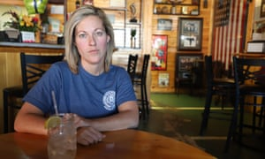 Hannah Gariepy sips glass after glass of water at Alec's Sports Bar in Jesup, Georgia. It's all she can afford as a federal prison employee during the shutdown, she says.