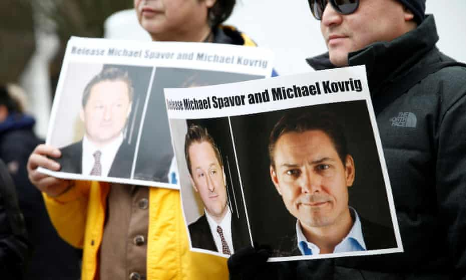 A protest against the detention of Michael Spavor and Michael Kovrig in Vancouver in 2019. Legal experts have denounced the charges against the two as baseless.