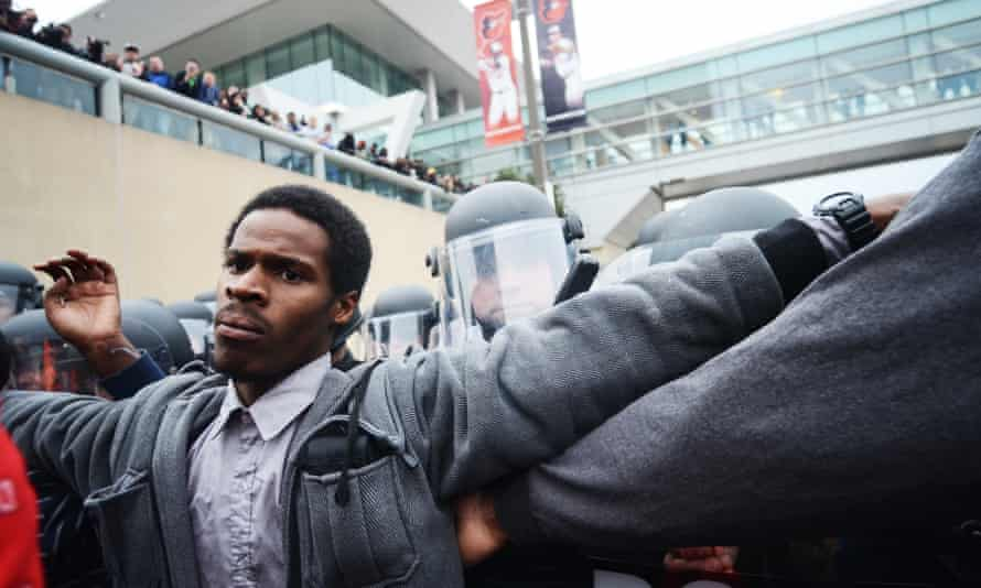 Shaun Young being arrested during recent protests. 'They're still going to do whatever the fuck they want to you but when you get in the paddy wagon you're going to have a buckle.'