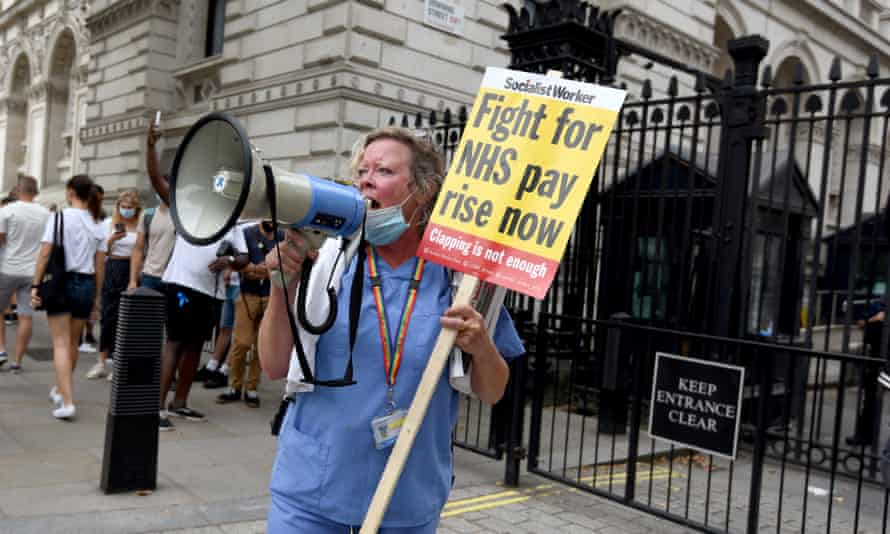 A nurse protesting in front of Downing Street.