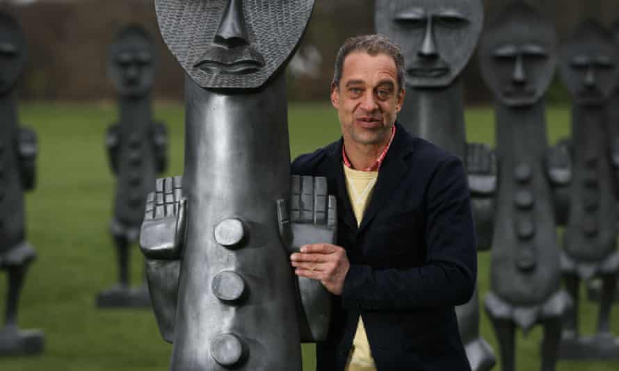The artist Zak Ové with one of his sculptures