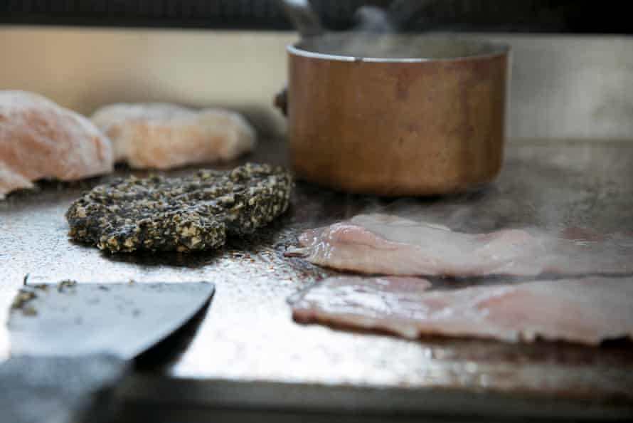 Preparing the full Welsh breakfast, bacon sizzles alongside a laverbread pattie.