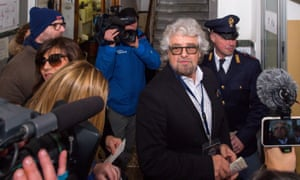 Beppe Grillo arrives at a polling station in Genoa to cast his vote in the Italian general election on Sunday.
