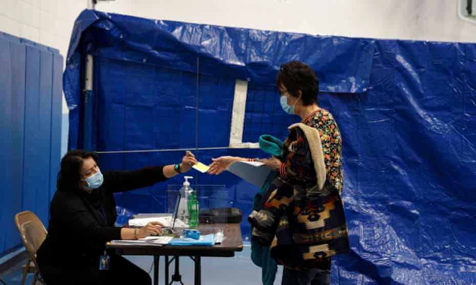 People from rural communities get their coronavirus vaccinations at Menominee Indian high school in Menominee, Wisconsin, in January. The pace of vaccinations has since slowed.