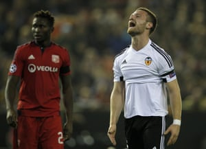 Valencia's Shkodran Mustafi reacts after smacking his header against the upright.