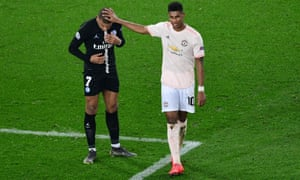 TOPSHOT-FBL-EUR-C1-PSG-MAN UTD<br>TOPSHOT - Manchester United's English forward Marcus Rashford (R) interacts with Paris Saint-Germain's French forward Kylian Mbappe at the end of the UEFA Champions League round of 16 second-leg football match between Paris Saint-Germain (PSG) and Manchester United at the Parc des Princes stadium in Paris on March 6, 2019. (Photo by Martin BUREAU / AFP)MARTIN BUREAU/AFP/Getty Images