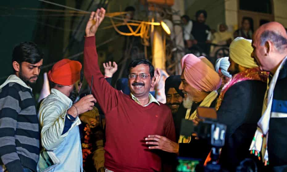 Indian Aam Aadmi party (AAP) chief Arvind Kejriwal greets supporters during an election rally in Delhi.