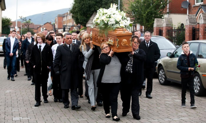 The coffin of Kevin McKee is carried to St Peter's Cathedral in Belfast by members of his family
