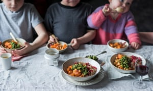 a child friendly tagine recipe being eaten at the dinner table by three children