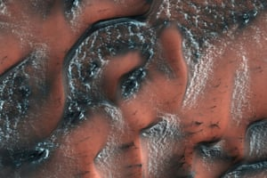 Mars Nasa's Mars reconnaissance orbiter shows snow and ice accumulated during the winter on dunes in the planet's northern hemisphere. Unlike on earth, this snow and ice is carbon dioxide, or dry ice