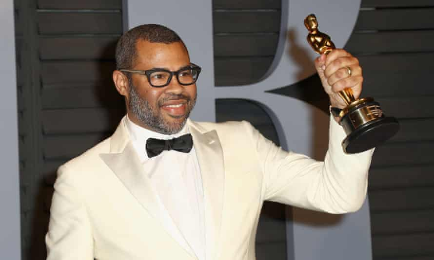 Get Out director Jordan Peele, with his award for best screenplay