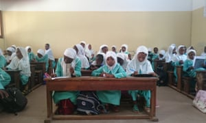 Girls take a test at the school in Yaoundé Central Mosque.
