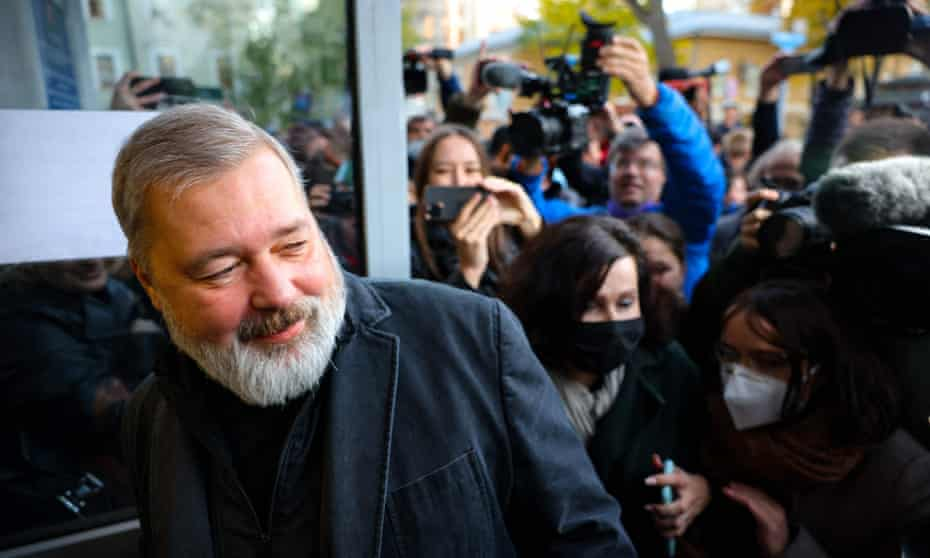 Dmitry Muratov is mobbed by supporters outside the Novaya Gazeta office in Moscow