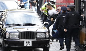 Protesters try to attack the car carrying the King of Bahrain as he arrives at Downing Street in London, October 2016.