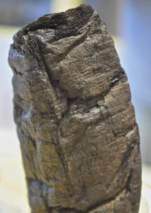 The charred remains of the papyrus scroll from Herculaneum.