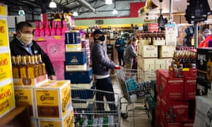 Customers queue to buy alcohol at a supermarket amid the ongoing coronavirus emergency lockdown in Johannesburg, South Africa, 18 August 2020.