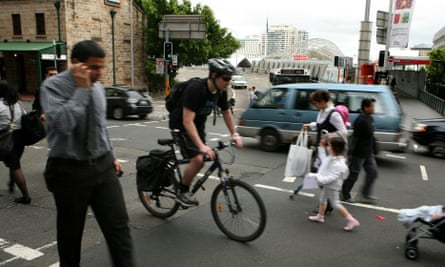 A cyclist rides through traffic in Sydney. Poor cycling infrastructure means most people who commute will spend some time on the roads with cars – travelling at a higher speed can feel safer.