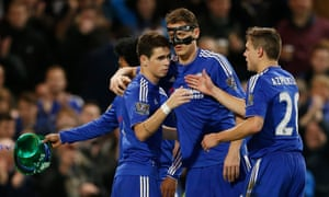 Oscar celebrates scoring the third goal for Chelsea from the penalty spot.