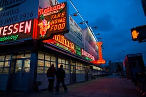 The facade of Nathan's glows against a cloudy sky as Hurricane Sandy approached and Coney Island was subject to a mandatory evacuation order in 2012