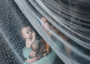 A woman holds her 10-month-old daughter
