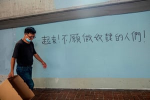 Graffiti on a wall in Hong Kong says: 'Arise, ye who refuse to be slaves', a line from China's national anthem. Residents have also co-opted quotes by Mao Zedong to pledge support for the pro-democracy cause, while avoiding the ban on protest slogans deemed illegal under the new law.